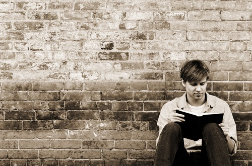 young_man_reading_