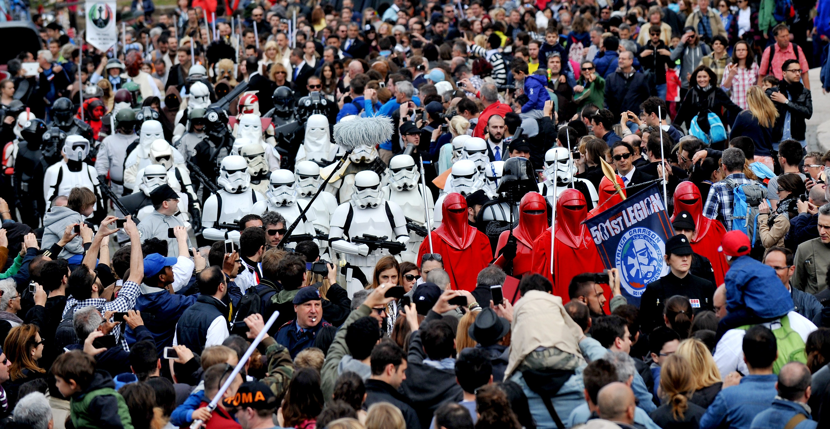 "Members of the Star Wars fan club celebrate ""Star Wars Day"" in front of the Colosseum in central Rome on May 4, 2014 AFP PHOTO / TIZIANA FABI        (Photo credit should read TIZIANA FABI/AFP/Getty Images)"